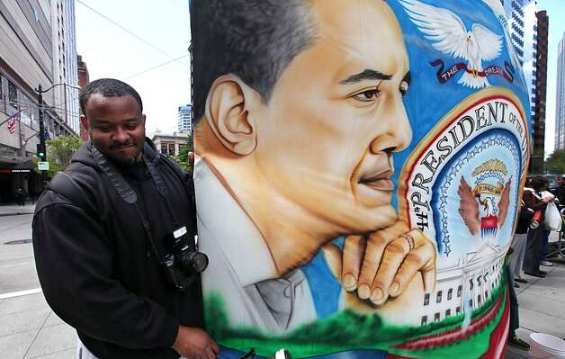 Rodney Upchurch stands with a large backdrop sign he made in support of the President Barack Obama outside a fundraising event for the president, Thursday, May 10, 2012, in Seattle. (AP Photo/Elaine Thompson) Photo: Elaine Thompson, Associated Press