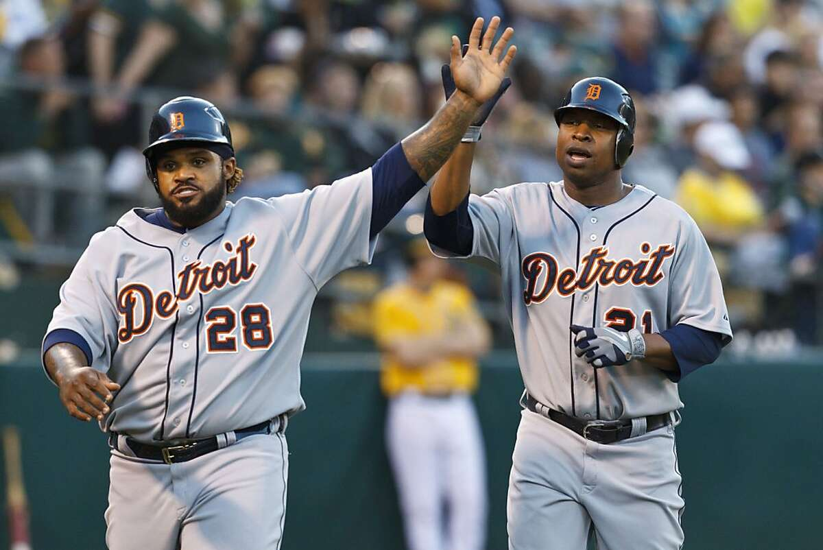 OAKLAND, CA - MAY 10: Prince Fielder #28 and Delmon Young #21 of the Detroit Tigers celebrate after scoring runs off a double hit by Alex Avila (not pictured) against the Oakland Athletics during the third inning at O.co Coliseum on May 10, 2012 in Oakland, California. (Photo by Jason O. Watson/Getty Images)