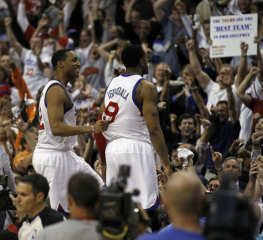 The Philadelphia 76ers' Andre Iguodala and Evan Turner, left, celebrate with fans after a 79-78 win against the Chicago Bulls in Game 6 of the Eastern Conference first-round playoff series at the Wells Fargo Center in Philadelphia, Pennsylvania, on Thursday, May 10, 2012. The win lifted the Sixers into the second round. (Yong Kim/Philadelphia Daily News/MCT) Photo: Yong Kim, McClatchy-Tribune News Service