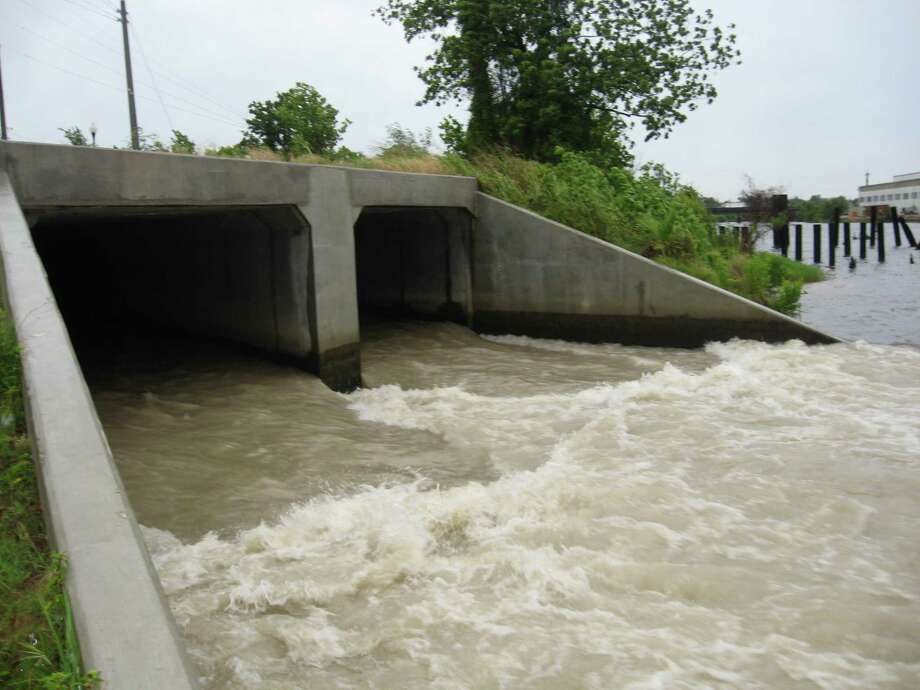 Heavy rain lashed Southeast Texas from about 4 a.m. through 7:30 a.m. Friday, but the region isn't done. More is expected this afternoon and  through early Saturday, the National Weather Service said. Pictured are the outfall of the Calder Avenue drainage project into the Neches River, and the lake level at the city's new event centre, given a little extra help from the skies. Dan Wallach/ The Enterprise Photo: Dan Wallach