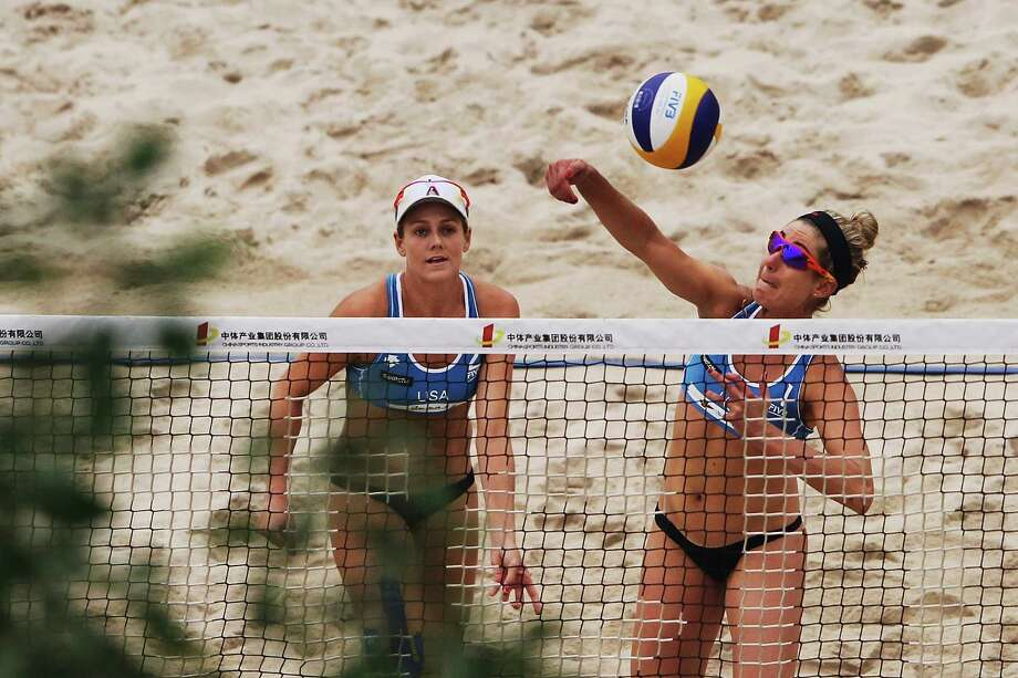 Jennifer Kessy (R) of the United States in action with team-mate April Ross during the 2012 Swatch FIVB World Tour Beijing Grand Slam Round 3 match against Sanne Keizer and Marleen Van Iersel of Netherlands in Chaoyang Park on May 11, 2012 in Beijing, China. Photo: Lintao Zhang, Getty Images / 2012 Getty Images