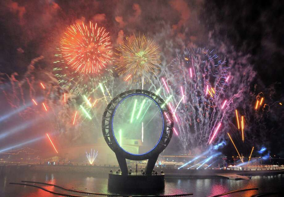 "Fireworks light up over the Big-O, a giant circular structure for nightly laser and light shows, during the opening ceremony of the Expo 2012 in Yeosu, a small city on South Korea's south coast, on May 11, 2012. After four years of work and 10 billion USD in investment, an international expo will start on May 12 at a glittering hi-tech venue on the site of a former dusty cement terminal in South Korea under the theme of ""The Living Ocean and Coast"".   AFP PHOTO / JUNG YEON-JEJUNG YEON-JE/AFP/GettyImages Photo: JUNG YEON-JE, AFP/Getty Images / AFP"