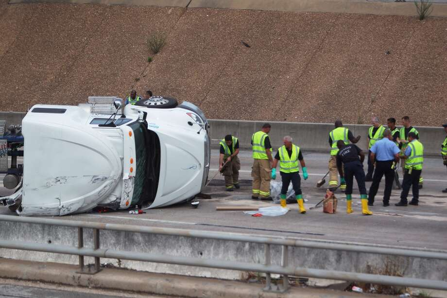 A big rig overturned in a traffic crash and spilled its load of flour on U.S. 59 near Texas 288 just south of downtown Friday morning, forcing officials to temporarily shutdown the freeway near the wreck site.  Photo: Johnny Hanson, Houston Chronicle