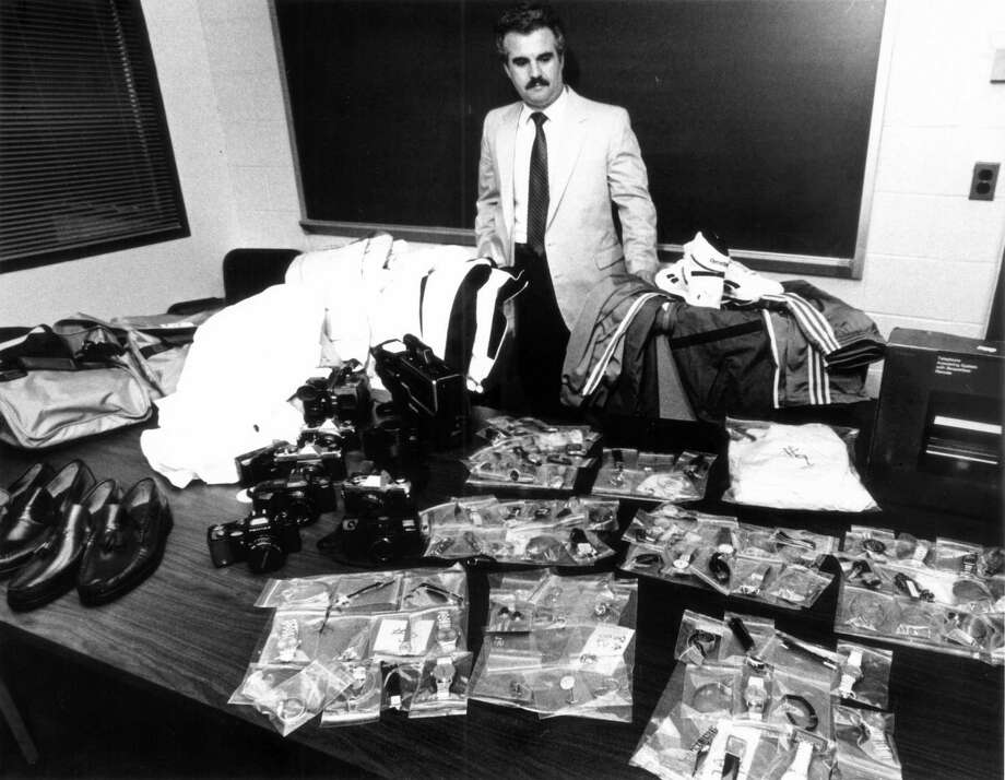 May 26, 1987: Stamford Police Lt. John Perrotta displays $10,000 worth of goods said to have been stolen on May 17th from J.C. Penney. Photo: File Photo