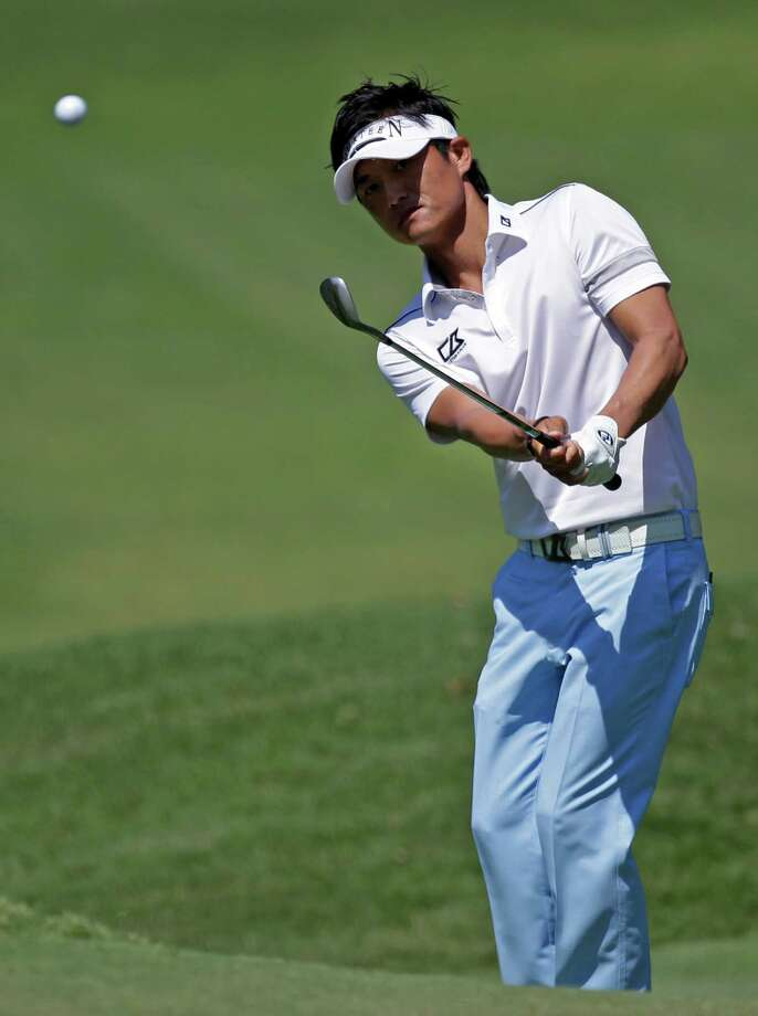 Ryuji Imada, of Japan,  chips to the eighth green during the second round of the Players Championship golf tournament at TPC Sawgrass, Friday, May 11, 2012, in Ponte Vedra Beach, Fla. (AP Photo/John Raoux) Photo: John Raoux, Associated Press / AP