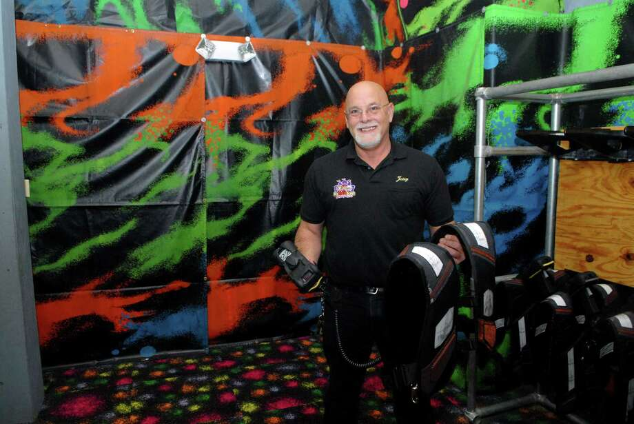 Jerry Petrini, owner of My Three Sons in Norwalk, Conn. on Friday May 11, 2012, with some of the new laser tag equiptment he was able to buy to expand his business through a grant from the Small Business Express Program. Photo: Dru Nadler / Stamford Advocate Freelance