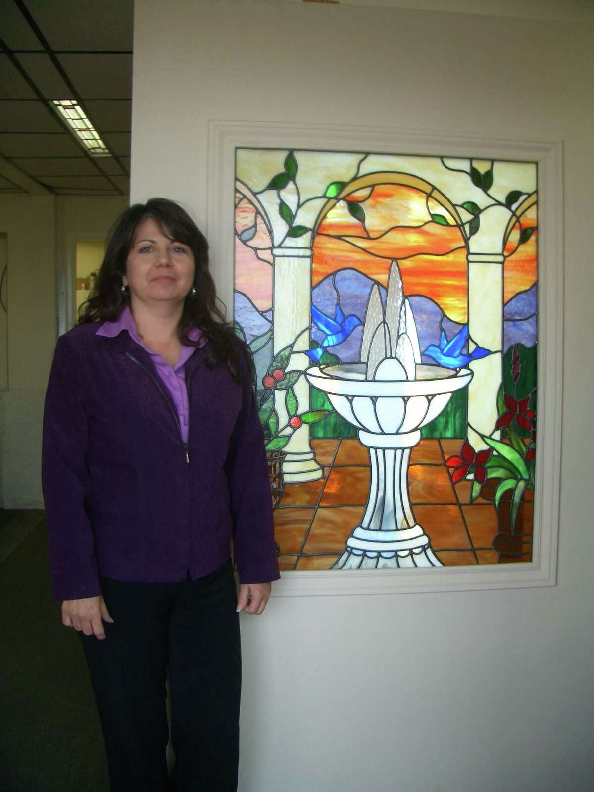 Teena Herrera designs stained-glass pieces, and her husband, Ralph, builds and installs the works they create at H and H Glass Design in San Antonio, Texas.