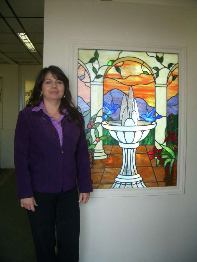 Teena Herrera designs stained-glass pieces, and her husband, Ralph, builds and installs the works they create at H and H Glass Design in San Antonio, Texas. Photo: Lily G. Casura