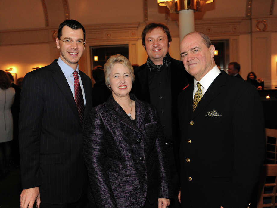 "Celebrating Houston Symphony's performance at Carnegie Hall's ""Spring for Music Festival"" at a reception in New York: Mark Hanson, from left, Mayor Annise Parker, vocalist Mikhail Svetlov and Hans Graf. Photo: Craig Chesek / Craig Chesek © Houston Symphony"