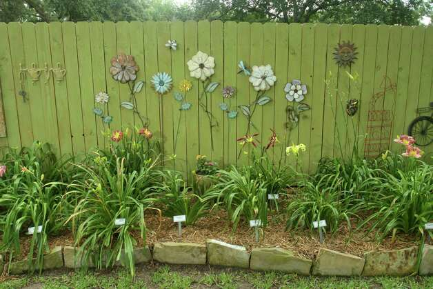 Karen and Loris Garrett have added floral art along a fence in their AHS Display Garden. Photo: Gary Fountain, Freelance / Copyright 2012 Gary Fountain.