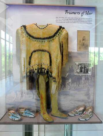 The Apache woman's shirt in this case dates to the late 1800s. It is on display at the South Texas Heritage Center at the Witte Museum.  May 9, 2012. Billy Calzada / San Antonio Express-News Photo: BILLY CALZADA, San Antonio Express-News / SAN ANTONIO EXPRESS-NEWS