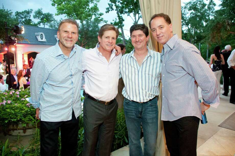 """At the """"A Gathering of Champions"""" fundraiser for Houston Children's Charity hosted by Paige and Tilman Fertitta at their River Oaks home: Tilman Fertitta, from left, Jeff Hildebrand, Brian Becker and Rich Handler Photo: Michelle Watson / © 2012 Michelle Watson. All rights reserved."""