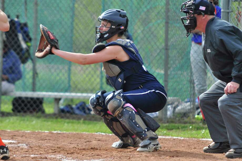 Staples catcher Magie Mills awaits a pitch from her pitcher in an earlier game. On Thursday, Mills had two hits in a 2-1 win over Trumbull. Photo: Tom Werner / Contributed Photo