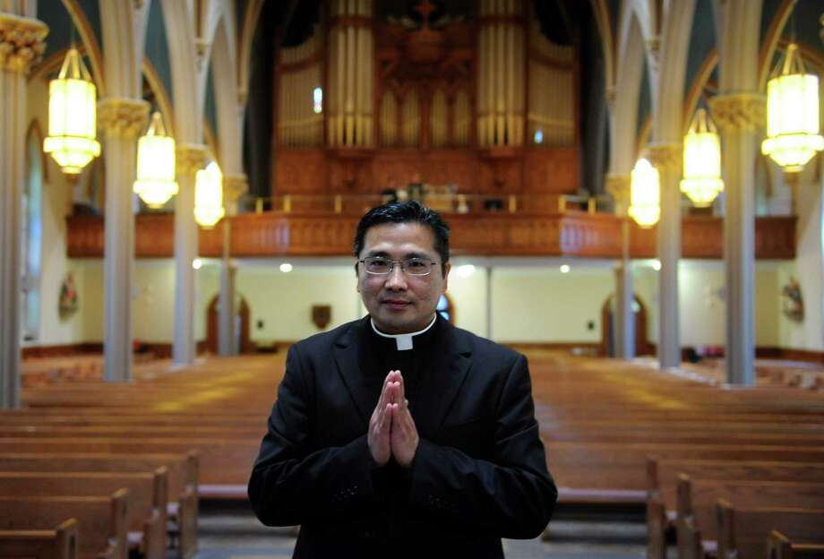 Augustine Tan Minh Nguyen, a Vietnamese refugee and University of Bridgeport graduate, rehearses for his ordination service at St. Augustine Cathedral in Bridgeport Friday, May 11, 2012.  Nguyen is being ordained as a priest in the Bridgeport Diocese on Saturday, May 12, 2012. Photo: Autumn Driscoll / Connecticut Post