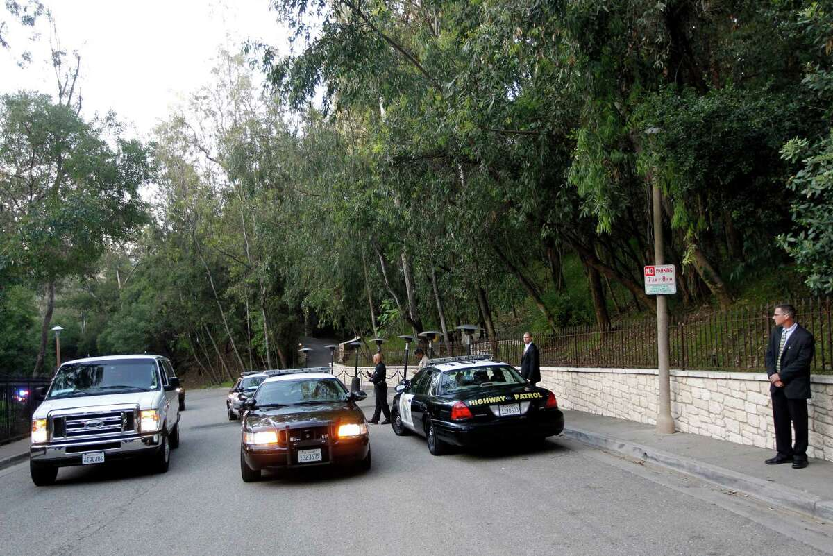 Law enforcement vehicles are parked outside the home of actor George Clooney, the site of a private fundraiser for President Barack Obama, Thursday, May 10, 2012, in Los Angeles. One hundred and fifty supporters will dine with Obama at Clooney?'s home, at a party organizers expect to gross $15 million for the President?'s re-election campaign. (AP Photo/Pablo Martinez Monsivais)