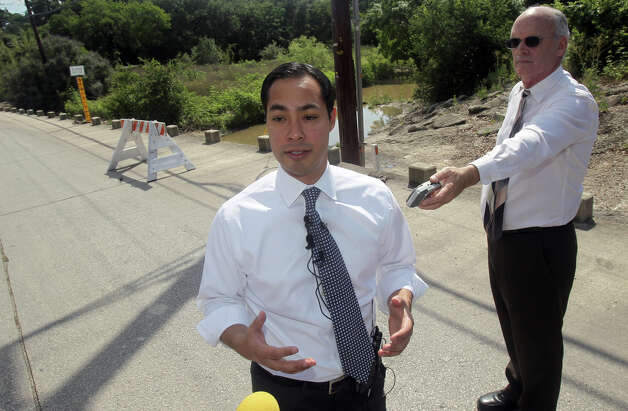 San Antonio mayor Julian Castro (center) speaks to the media about the May 12, 2012 bond election at a low water crossing Friday May 11, 2012 near Nakoma and West Avenue. If the bond passes, the bridge at this location will cost $6.6 million. John Davenport/San Antonio Express-News Photo: SAN ANTONIO EXPRESS-NEWS