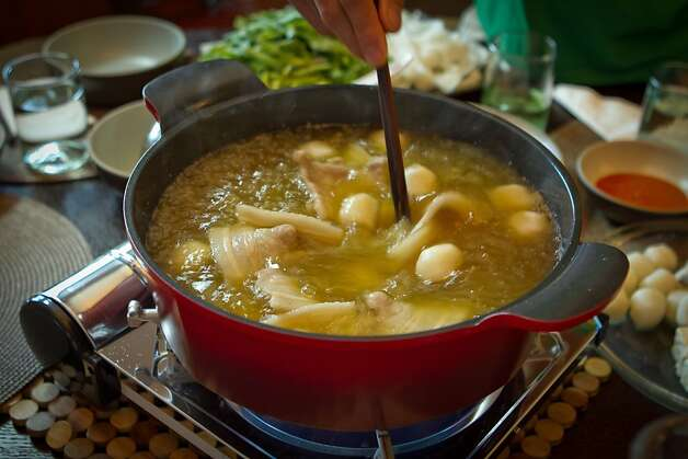 Chef James Syhabout of Commis stirs the Thai Hot Pot at his home in Oakland, Calif., on Tuesday, May 1st, 2012. Photo: John Storey