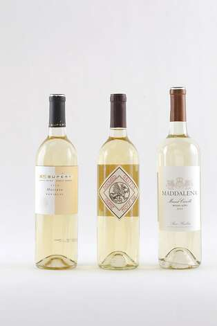 Domestic Muscats, from left: 2010 Maddelena Paso Robles Muscat Canelli, 2010 St. Supery Napa Valley Moscato, 2010 Barnard Griffin Yakima Valley Orange Muscat. Photo: Craig Lee, Special To The Chronicle