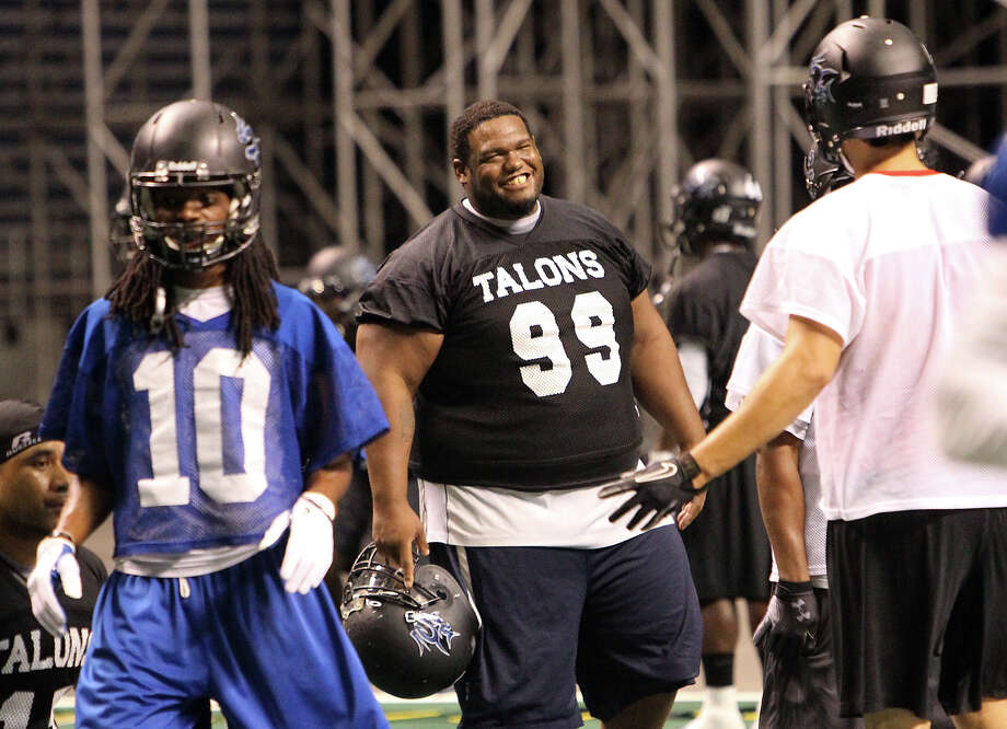 San Antonio Talons' Jamar Ward (99) shares a laugh with teammates during practice with the team on Thursday, May 10, 2012. Kin Man Hui/Express-News. Photo: Kin Man Hui, SAN ANTONIO EXPRESS-NEWS / San Antonio Express-News