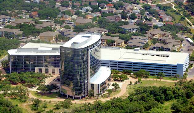 Tesoro Corporation's 618,000 square foot headquarters building, located in RidgeWood Park, a 122-acre master-planned business community, is seen in this April 10, 2012 aerial photo. (William Luther/wluther@express-news.net) Photo: William Luther, San Antonio Express-News / © 2012 WILLIAM LUTHER