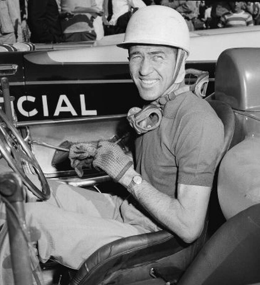 FILE - In this Feb. 22, 1958 file photo, Carroll Shelby, sits in a car at the Havana Grand Prix time trial in Havana. Shelby, the legendary race driver and Shelby Cobra sports car designer, has died at age 89. Shelby's company Carroll Shelby International says Shelby died Thursday, May 10, 2012, at a Dallas hospital. He had received a heart transplant in 1990 and a kidney transplant in 1996. (AP Photo, File) (AP)