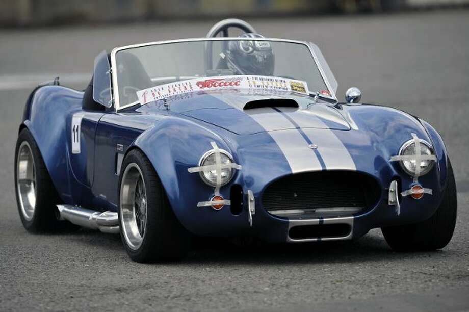Colombian driver Michael Santins, drives his AC Shelby Cobra, of 1965, during a race of classic and vintage cars on the track of Cavasa, in Candelaria, Valle del Cauca department, Colombia, on November 7, 2010. It is first time that 52 cars manufactured before 1975 participate in a race.  AFP PHOTO/Luis ROBAYO (Photo credit should read LUIS ROBAYO/AFP/Getty Images) (LUIS ROBAYO / AFP/Getty Images)