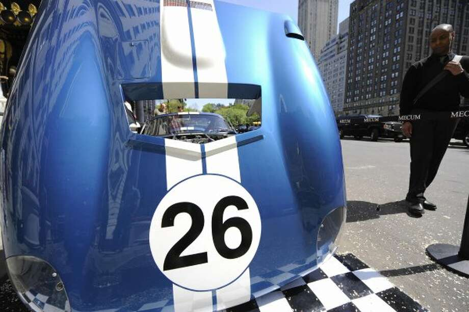 The 1965 Shelby Daytona Cobra Coupe CSX260 stands on display in front of New York's Plaza Hotel,  during an auction preview in New York, April 28, 2009. The 1965 Shelby Daytona Cobra was one of six car built by Carroll Shelby and the first American race car to ever beat Ferrari in the world manufacturers racing championship. The car will presented on May 15, 2009 at an auction in Indianapolis and is expected to fetch a world record price for a car, with an estimate of 10-15 million USD. AFP PHOTO/Emmanuel Dunand (Photo credit should read EMMANUEL DUNAND/AFP/Getty Images) (EMMANUEL DUNAND / AFP/Getty Images)