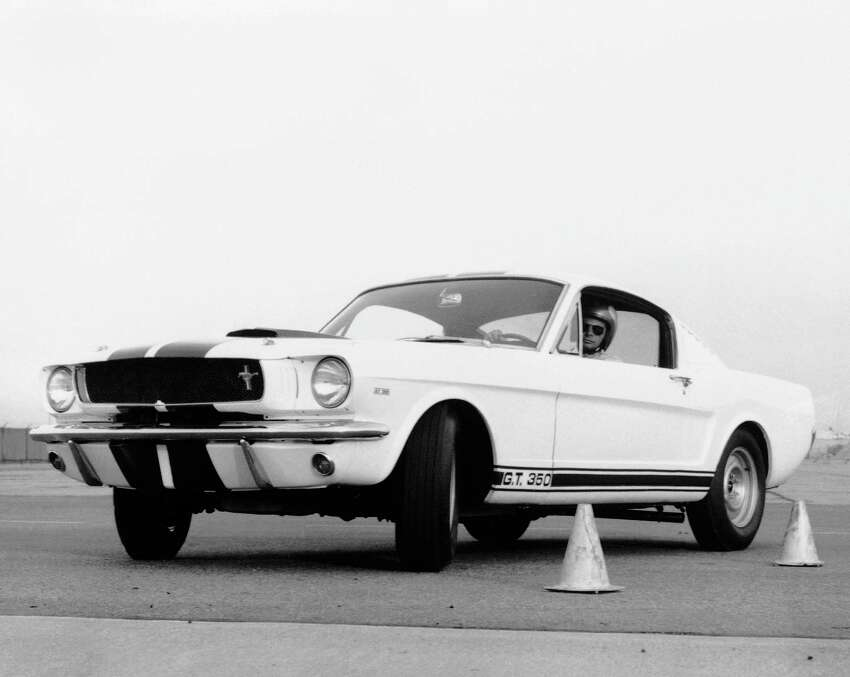 FILE - The Mustang GT 350, is shown in this March 1965 file photo as the car to beat in sports car club of American Class B production racing. The sleek fastback built by Carroll Shelby attracts high interest among sports car enthusiasts. Shelby, the legendary race driver and Shelby Cobra sports car designer, has died at age 89. Shelby's company Carroll Shelby International says Shelby died Thursday, May 10, 2012, at a Dallas hospital. He had received a heart transplant in 1990 and a kidney transplant in 1996. (AP Photo, File)
