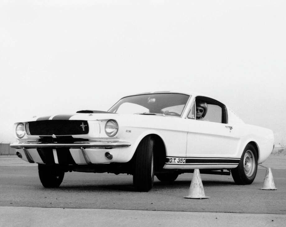 FILE - The Mustang GT 350, is shown in this March 1965 file photo as the car to beat in sports car club of American Class B production racing. The sleek fastback built by Carroll Shelby attracts high interest among sports car enthusiasts. Shelby, the legendary race driver and Shelby Cobra sports car designer, has died at age 89. Shelby's company Carroll Shelby International says Shelby died Thursday, May 10, 2012, at a Dallas hospital. He had received a heart transplant in 1990 and a kidney transplant in 1996. (AP Photo, File) Photo: Anonymous, - / 1965 AP