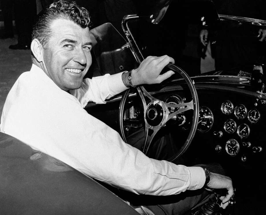 FILE - In this 1964 file photo, auto racer Carroll Shelby, sits in a car. Shelby, the legendary race driver and Shelby Cobra sports car designer, has died at age 89. Shelby's company Carroll Shelby International says Shelby died Thursday, May 10, 2012, at a Dallas hospital. He had received a heart transplant in 1990 and a kidney transplant in 1996. (AP Photo, File) Photo: Anonymous, - / AP1964