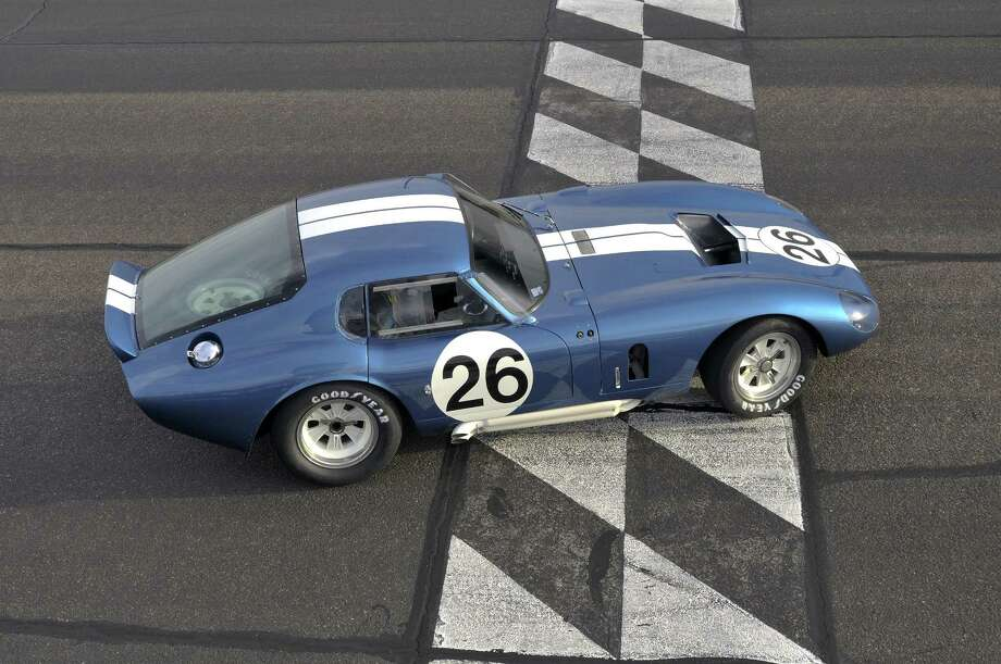 The 1965 Shelby Cobra Daytona Coupe that won the FIA Championship, in an undated handout photo. The upstart Cobra, the unlikely offspring of England's venerable but tiny A.C. Cars, and a single relentlessly ambitious Texan, Carroll Shelby, a World War II fighter pilot, turned sports car constructor, would continue stirring enthusiasts' souls well into the next century. (David Newhardt/Mecum Auctions via The New York Times) - NO SALES; FOR EDITORIAL USE ONLY WITH STORY SLUGGED AUTOS SHELBY COBRA ADV01 BY JAMIE LINCOLN KITMAN. ALL OTHER USE PROHIBITED. - PHOTO MOVED IN ADVANCE AND NOT FOR USE - ONLINE OR IN PRINT - BEFORE APRIL 1, 2012. - Photo: DAVID NEWHARDT, - / MECUM AUCTIONS