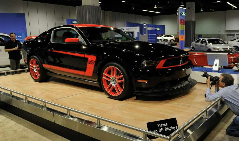 A man looks at the new 2010 Ford Mustang on display at the Orange County Auto Show in Anaheim on October 7, 2010.  The car has a Supercharged 550-HP Shelby GT500 V8 engine and is available as a coupe, convertible or glass roofed models.               AFP PHOTO/Mark RALSTON Photo: MARK RALSTON, Getty Images / 2010 AFP