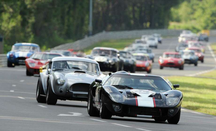 """German driver Christian Glasel (R) in his Ford GT 40 competes ahead of Portuguese Miguel Amaral (2nd) in his 1964's AC Cobra during the 5th edition of the """"Le Mans classic race"""" on July 11, 2010 at Le Mans, western France. This event, which takes place every two years, gathers cars manufactured from 1957 to 1961 which have already competed in Le Mans 24-hour endurance race from 1923 to 1970. AFP PHOTO / JEAN FRANCOIS MONIER Photo: JEAN FRANCOIS MONIER, Getty Images / 2010 AFP"""