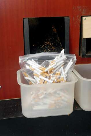 Machine rolled cigarettes at Tracey's Smoke Shop and Tobacco LLC in Norwalk, Conn. on Friday May 11, 2012. The state is trying to force her to pay cigarette taxes on roll-your-own smokes, either in court or through legislation. Photo: Dru Nadler / Stamford Advocate Freelance