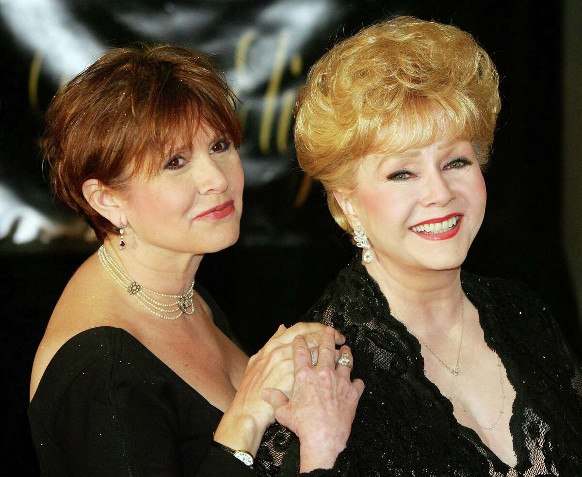 HENDERSON, NV - FEBRUARY 27: Actress Carrie Fisher (L) and her mother, actress Debbie Reynolds, arrive for Dame Elizabeth Taylor's 75th birthday party at the Ritz-Carlton, Lake Las Vegas on February 27, 2007 in Henderson, Nevada. (Photo by Ethan Miller/Getty Images) *** Local Caption *** Carrie Fisher; Debbie Reynolds