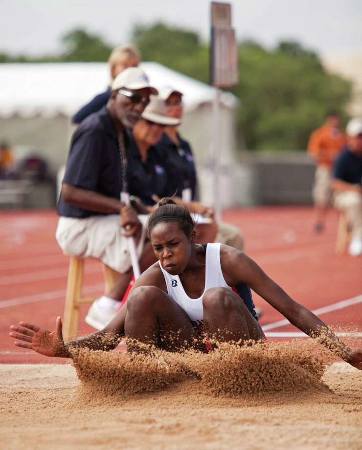 Porsha Thomas of Pearland Dawson takes a jump during the girl's long jump event at the UIL 4A state track meet at Mike A. Myers Track & Soccer Stadium in Austin, Texas on May 11, 2012. Photo: Thao Nguyen, Houston Chronicle / Thao Nguyen