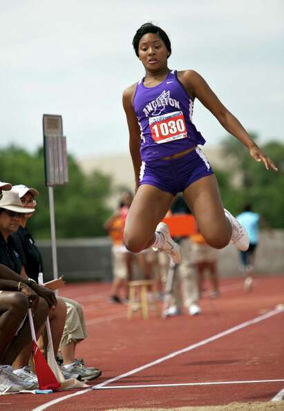Ashley Lee of Angelton takes a jump during the girl's long jump event at the UIL 4A state track meet