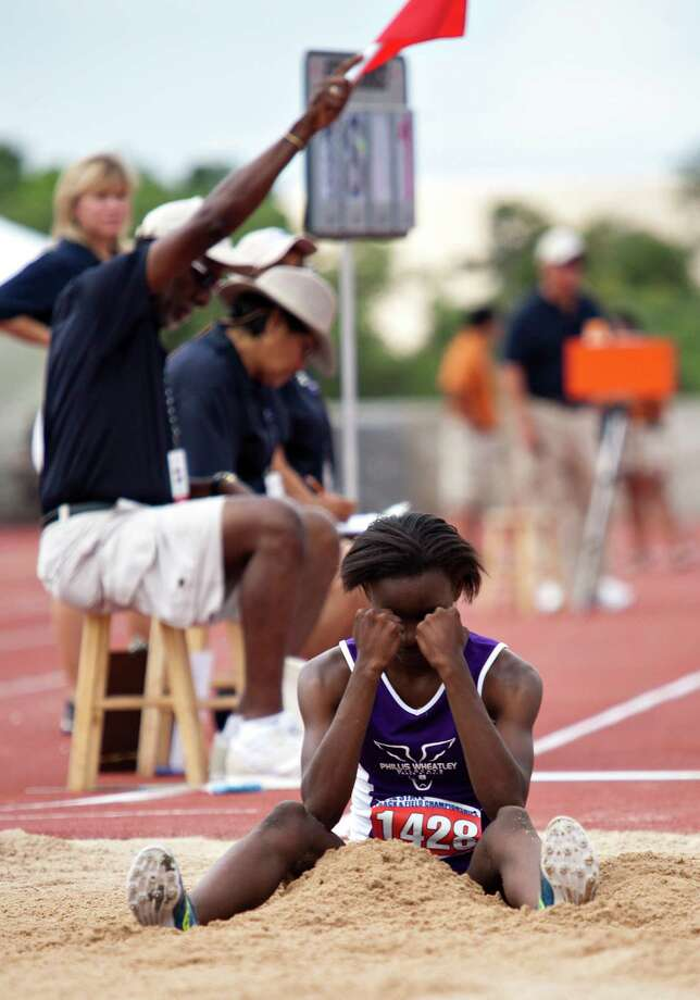 Daye Shon Roberson of HO Wheatley reacts after a bad jump during the girl's long jump event at the UIL 4A state track meet at Mike A. Myers Track & Soccer Stadium in Austin, Texas on May 11, 2012. Photo: Thao Nguyen, Houston Chronicle / Thao Nguyen