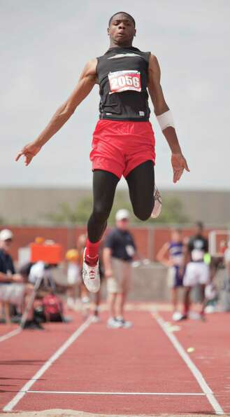 Chris Polk of  BA Goose Creek takes a jump during the boy's long jump event at the UIL 4A state trac