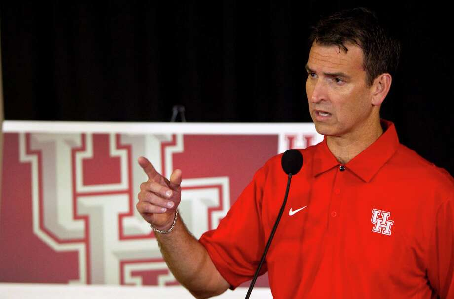 University of Houston athletic director Mack Rhoades explains why he wanted to change he UH logo during a press conference, Tuesday, April 10, 2012, in Houston. The new UH logo will not have navy blue and an embossed look to the block letters. Photo: Nick De La Torre, Houston Chronicle / © 2012  Houston Chronicle