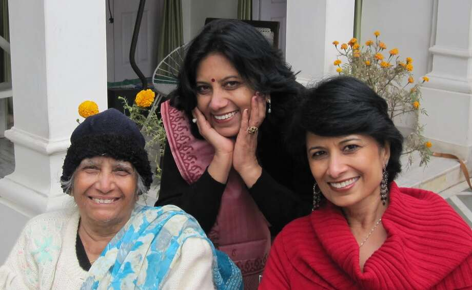 Renu Khator, above right, the president of the University of Houston, says her mother, Suman Maheshwari, above left, made it clear she had high expectations for her children as they were growing up in a small town in India. Rita Kabra, Khator's sister, is in the center of the photo. Below, Khator attends the Opera Ball in Houston with her husband, Suresh Khator.