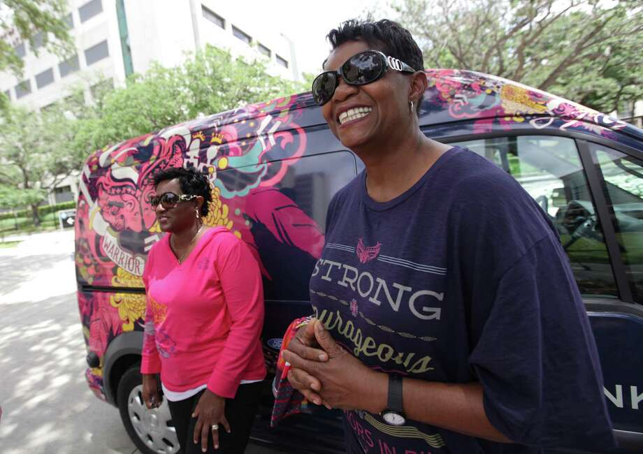 "Cancer survivors Lisa Edwards-Benford, 47, and mother Ruby Wilson, 67, were chosen to be ""Models of Courage"" by Ford Motor Company and participate in the mini Art Car Parade through the Medical Center on Friday. Photo: Mayra Beltran / Houston Chronicle"