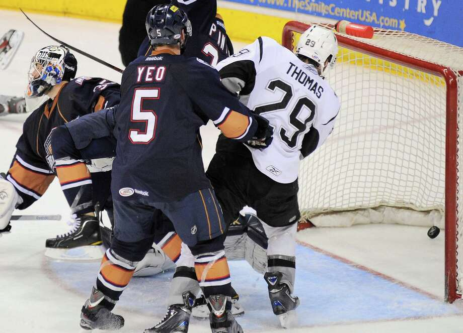 San Antonio Rampage's Bill Thomas (29) watches the puck sail into the net past Oklahoma City Barons goaltender Yann Danis, left, and Barons' Dylan Yeo (5) during the second period of an AHL hockey game, Friday, May 11, 2012, in San Antonio. Photo: Darren Abate, Darren Abate/pressphotointl.com / Darren Abate/pressphotointl.com