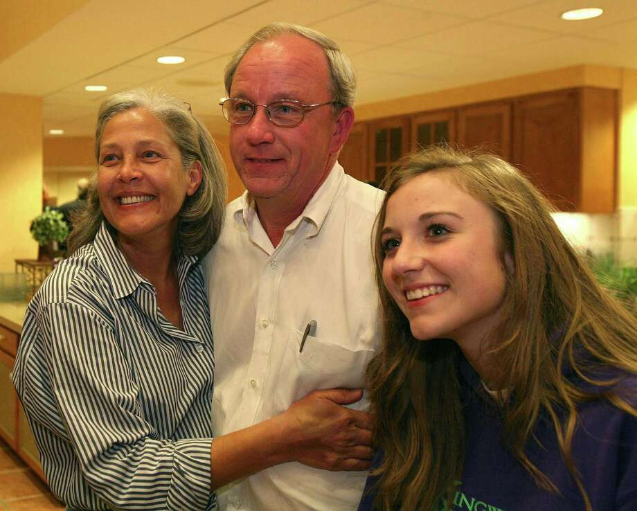Mike Sullivan (center) gets a hug from his wife, Kim Sullivan (left) as they and their daughter, Paige Sullivan, 15 (right) hear favorable returns. Sullivan is a candidate for Houston City Council District E, gathered with supporters at the Hilton Homewood Suites in Kingwood to watch returns. (Tuesday, Nov. 6, 2007, in Houston. ( Steve Campbell / Chronicle) Photo: Steve Campbell / Houston Chronicle