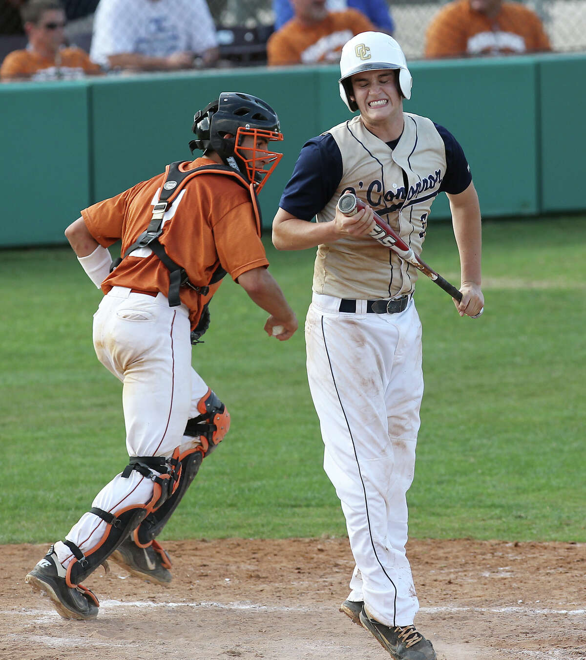 O'Connor's Lance Ellling (cq), right, reacts after striking out in the fifth inning against Madison in game 1 of a best of three series of the second round of Class 5A playoffs at NEISD on Friday, May 11, 2012. Madison defeated O'Connor, 7-2. Kin Man Hui/Express-News.
