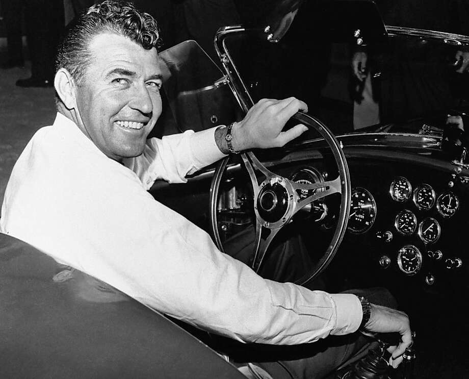 FILE - In this 1964 file photo, auto racer Carroll Shelby, sits in a car. Shelby, the legendary race driver and Shelby Cobra sports car designer, has died at age 89. Shelby's company Carroll Shelby International says Shelby died Thursday, May 10, 2012, at a Dallas hospital. He had received a heart transplant in 1990 and a kidney transplant in 1996. (AP Photo, File) Photo: Anonymous, Associated Press