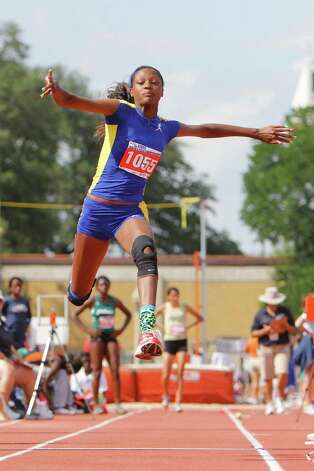 Ozen's Dominique Brannon competes in the 4A girls triple jump at the UIL Track & Field State meet at Mike A. Myers Stadium in Austin.  May 11, 2012.  Valentino Mauricio/The Enterprise Photo: Valentino Mauricio