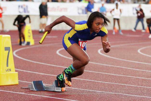 Ozen's Asia Booker blasts out of the blocks at the start of the 4A girls 800 relay. Ozen captured a third place finish in the relay at the UIL Track & Field State meet at Mike A. Myers Stadium in Austin.   May 11, 2012.  Valentino Mauricio/The Enterprise Photo: Valentino Mauricio