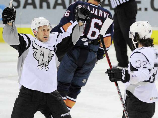 San Antonio Rampage's Jon Matsumoto, left, celebrates a goal with teammate Scott Timmins during the third period of an AHL hockey game against the Oklahoma City Barons, Friday, May 11, 2012, in San Antonio. Oklahoma City won 4-3. Photo: Darren Abate, Darren Abate/pressphotointl.com / Darren Abate/pressphotointl.com