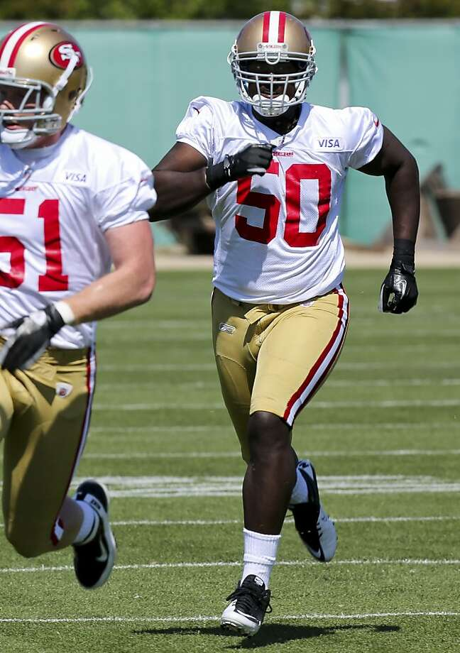 Line Backer Cam Johnson, 50, runs defensive drills during the 49ers rookie minicamp at the 49ers practice field on Friday, May 11, 2012 in Santa Clara, Calif. Photo: John Sebastian Russo, Special To The Chronicle